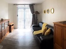 Sunny 2 bedroom furnished apartment in a secure well located spot in Cape Town