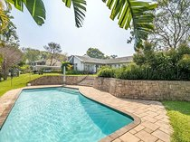 Sunny and immaculate home offering privacy, space, and a modern two bed cottage