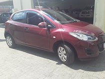 Maroon mazda 2 1.5 dynamic with 93000km available now!