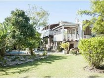A renovators dream on a large stand in leafy hunters home